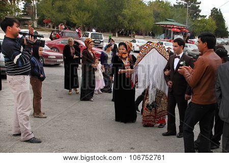 Kov-ata, Turkmenistan -  October 18. 2015. The Bride And Groom In The Turkmen National Dress, Photog