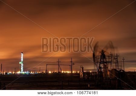 Oil Pump Jack And Drilling Rig.
