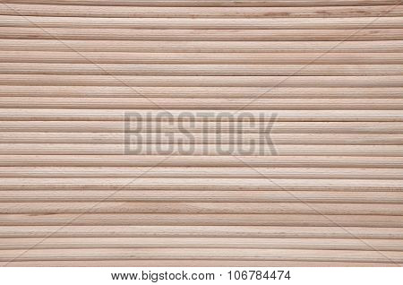 Wooden stakes in rows as background texture