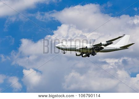 Plane On The Blue Sky Background