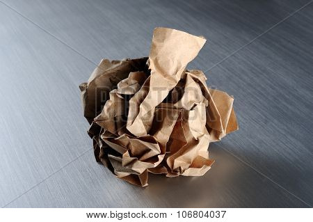 A close-up of crumpled piece of brown paper poster