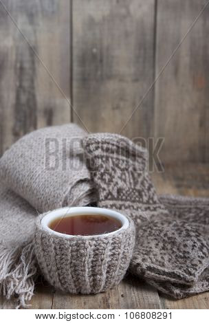A Cup Of Hot Tea , Scarf And Gloves With Ornament.