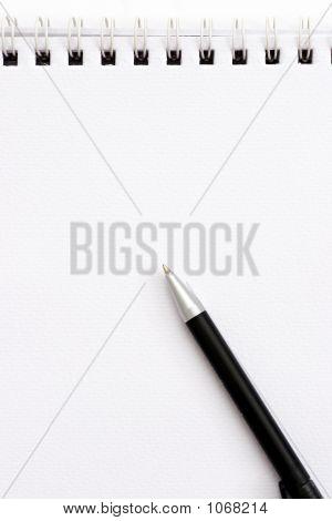 Pen On White Spiral Notebook