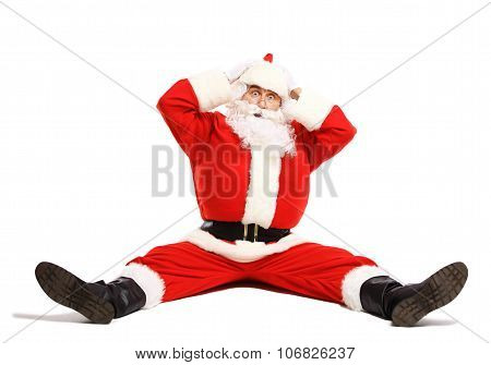Hilarious and funny Santa Claus confused while sitting on a white background full length poster