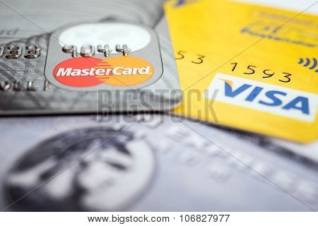 Vilnius, Lithuania - October 30, 2015: Closeup studio shot of credit and debit cards issued by American Express, VISA and MasterCard