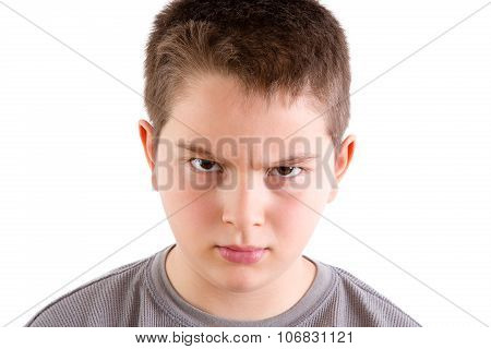 Stern Looking Boy With Furrowed Brow