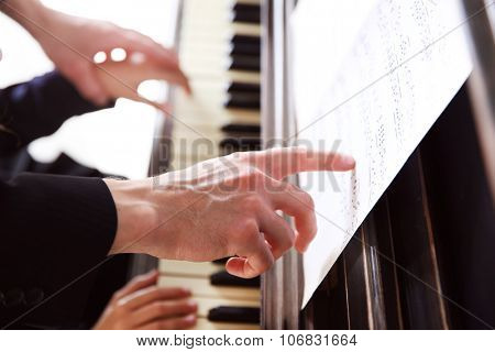 Close up of musician man and girl hands piano playing poster