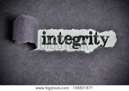 Integrity Word Under Torn Black Sugar Paper