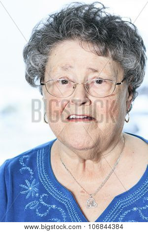 A portrait of a 90 years old senior in is apartment
