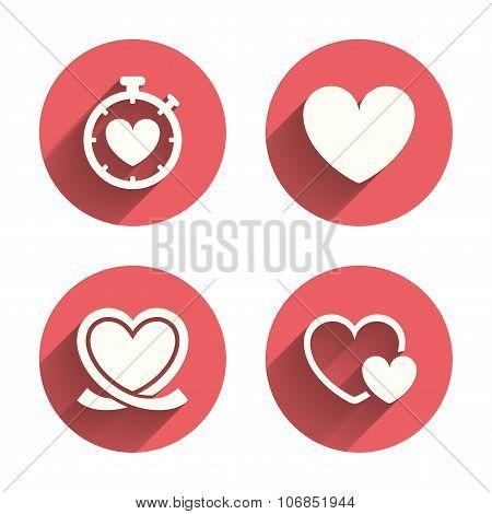 Heart ribbon icon. Timer stopwatch symbol.