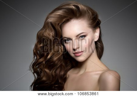 Model with long hair. Waves Curls Hairstyle. Hair Salon. Updo. Fashion model with shiny hair. Woman with healthy hair girl with luxurious haircut. Hair loss Girl with hair volume.  poster