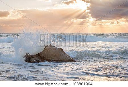 Sea Waves Crashing Against The Rocks.
