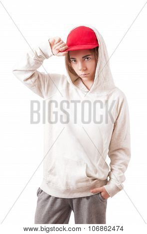 Teenager In A Red Cap And Sportswear