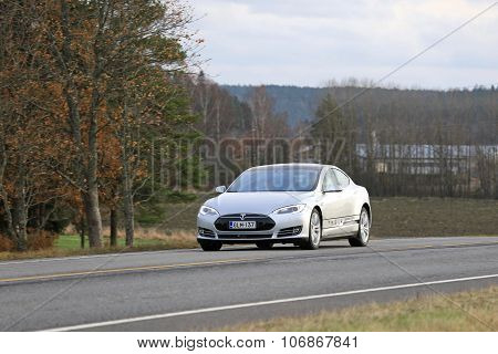 Silver Tesla Model S Electric Car On The Road