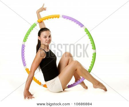 Young Gymnast Takes Athletic Exercises