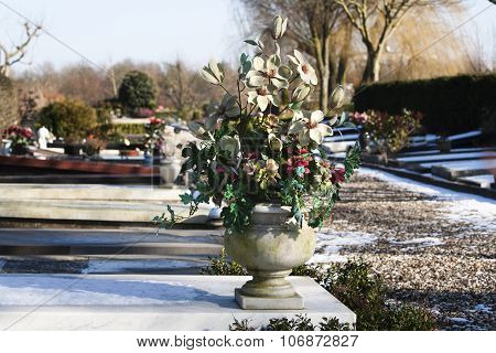 Artificial Flowers On A Grave
