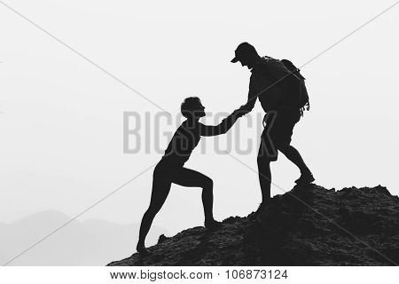 Teamwork Helping Hand Couple Hiking Climbing