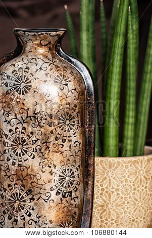 Ceramic Vase With Artistic Pattern And Potted Plant