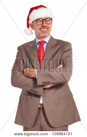 smiling old santa businessman standing with hands folded looks away and smiles on white background
