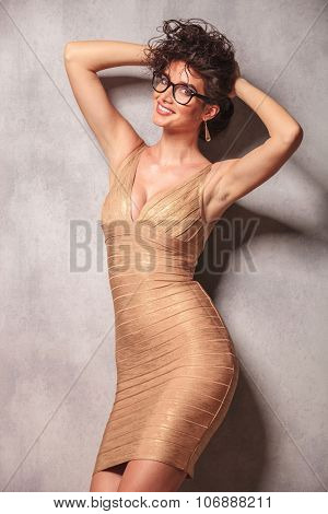 sexy woman wearing glasses, pose while holding her hair with both hands