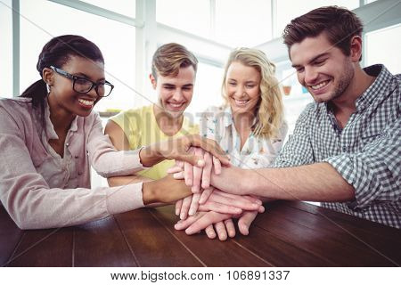Creative businessteam making a large motivation gesture in casual office
