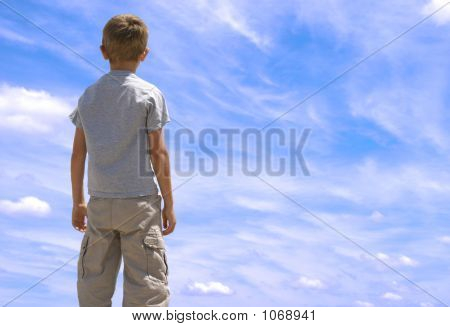 Boy Looking Toward Sky