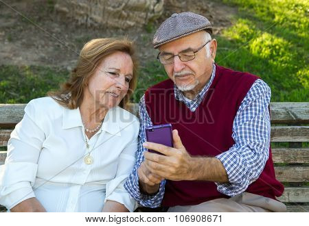 Senior Man And Senior Woman Doing A self-portrait