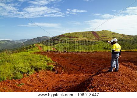 Mining construction workers on mountain top in Sierra Leone