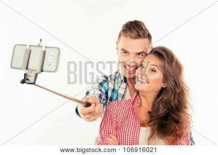 Happy Cute Couple In Love Making Selfie Photo With Selfie Stick