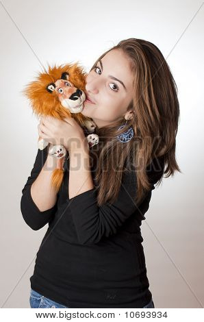 Young Girl With Her Lion Toy