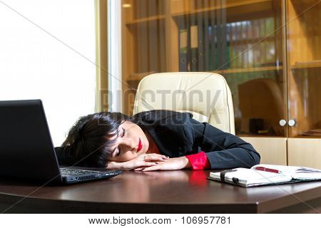 Beautiful Girl Sleeping At His Desk In The Office