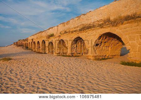 Ancient Roman Aqueduct At Sunset