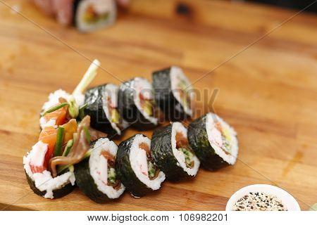 Sushi master preparing sushi in Japanese restaurant . poster