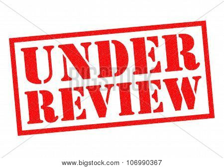 UNDER REVIEW red Rubber Stamp over a white background. poster