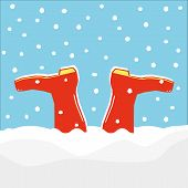 A pair of red wellington boots or galoshes stuck upside down in a drift made by falling snow poster