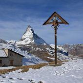 Catholic cross on the Riffelberg and Matterhorn. Scene on the Gornergrat, Zermatt. poster