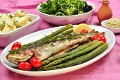 grilled rainbow trout with organic green asparagus poster