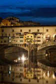 View of Gold (Ponte Vecchio) Bridge at night in Florence, Tuscany, Italy poster