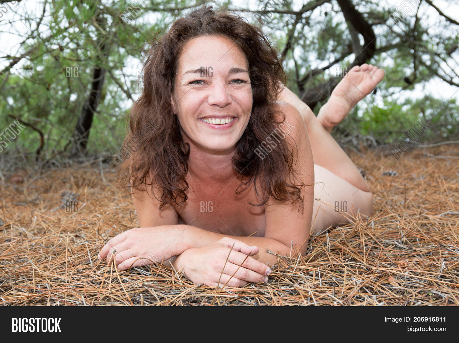 Sexy poses naked woman at the beach