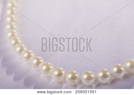 Pearls strand on white background studio shot