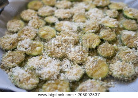 zucchini gratinéèd with parmesan cheese and breadcrumb