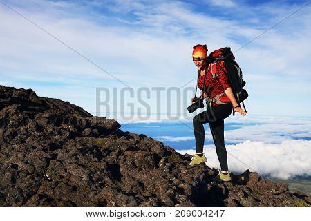 Young girl trekking on Pico volcano (2351m) on Pico Island, Azores, Portugal, Europe