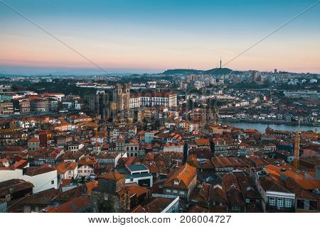 Bird's-eye view old downtown of Porto at dusk, Portugal.
