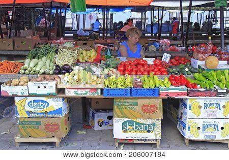 Woman Is Selling Vegetables At Street Market In Novi Sad