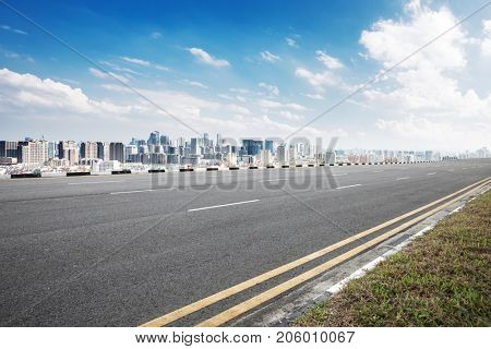 empty asphalt road and cityscape of nanjing in blue sky