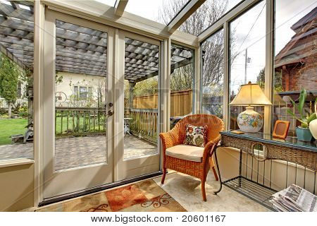 Garden Room Wall With Clhair And Deck