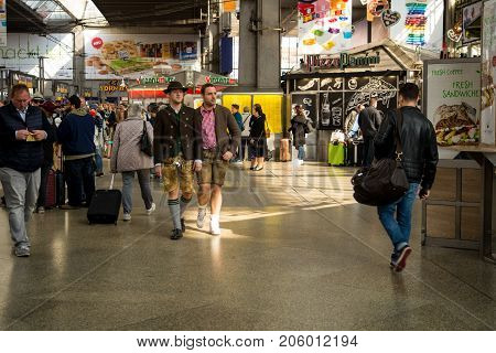 MunichGermany-September 242017:Two men in traditional bavarian clothes talk at Munich Central station