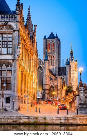 Gent Belgium with Graslei district Saint Nicholas Church and Belfort tower at twilight illuminated moment in Flanders.