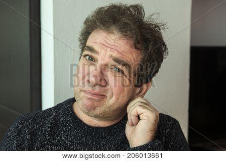 Sad distraught man close-up portrait