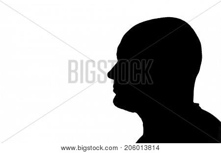 Close-up silhouette of a bald-headed man